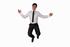 O homem de negócios feliz que salta no ar isolou-se Foto de Stock Royalty Free