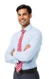 O homem de negócios feliz Standing With Arms cruzou-se Imagens de Stock Royalty Free