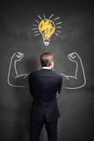O homem de negócios forte tem uma ideia Imagem de Stock Royalty Free