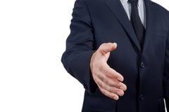O homem de negócios guarda para fora sua mão para fazer um acordo Fotos de Stock Royalty Free