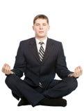 O homem de negócios meditate, isolado no branco imagens de stock royalty free