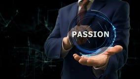 O homem de negócios mostra a paixão do holograma do conceito em sua mão imagem de stock