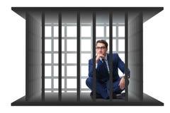 O homem de negócios na gaiola isolada no branco Imagem de Stock