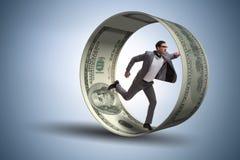 O homem de negócios na roda do hamster que persegue dólares imagem de stock royalty free