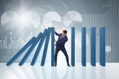 O homem de negócios no conceito do negócio do efeito de dominó foto de stock royalty free
