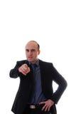 O homem de negócios novo aponta seu dedo Fotografia de Stock Royalty Free