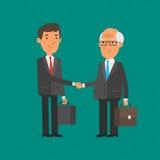 O homem de negócios novo e velho agita as mãos Fotos de Stock Royalty Free