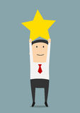 O homem de negócios obtém um troféu dourado da estrela Fotografia de Stock Royalty Free