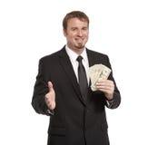 O homem de negócios oferece o aperto de mão com dinheiro fotos de stock