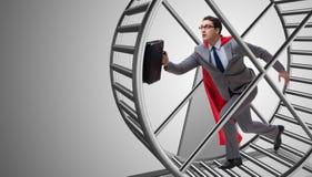 O homem de negócios que corre na roda do hamster foto de stock
