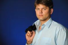 O homem de negócios que fala por um telefone móvel Foto de Stock