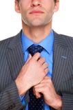 O homem de negócios que faz seu amarra acima Imagem de Stock Royalty Free
