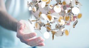 O homem de negócios que guarda a moeda do voo inventa em seu renderi da mão 3D Foto de Stock