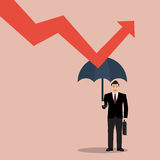O homem de negócios que guarda o guarda-chuva protege o gráfico para baixo Imagem de Stock
