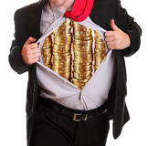 O homem de negócios que rasga sua camisa empilha moedas nela foto de stock royalty free
