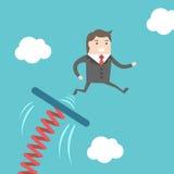 O homem de negócios que salta do trampolim Imagem de Stock