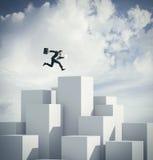 O homem de negócios que salta em um cubo rendição 3d Fotos de Stock Royalty Free