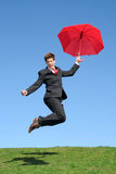 O homem de negócios que salta para a alegria Foto de Stock Royalty Free