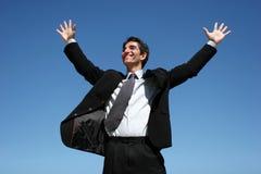 O homem de negócios que salta para o sucesso imagem de stock