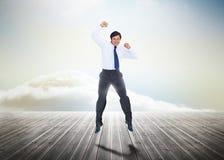 O homem de negócios que salta sobre placas de madeira Imagens de Stock Royalty Free