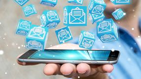 O homem de negócios que usa o cubo de flutuação envia por correio eletrónico a rendição 3D Fotografia de Stock Royalty Free
