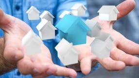 O homem de negócios que usa 3D rendeu casas brancas e azuis pequenas Imagem de Stock Royalty Free