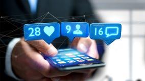 O homem de negócios que usa um smartphone com a gosta, seguidor e messag Foto de Stock Royalty Free