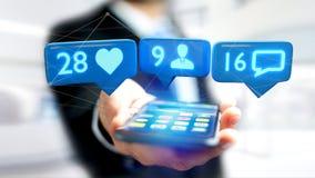 O homem de negócios que usa um smartphone com a gosta, seguidor e messag Fotografia de Stock Royalty Free