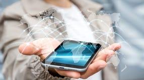 O homem de negócios que usam a rede global e as trocas de dados '3D rendem Fotografia de Stock