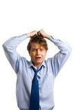 O homem de negócios rasga seu cabelo foto de stock