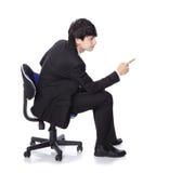 O homem de negócios sentam-se e o espaço da cópia do ponto do dedo Foto de Stock Royalty Free