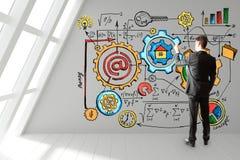 O homem de negócios tira um plano startup na parede Fotografia de Stock Royalty Free
