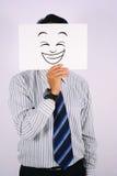 O homem de negócios Wearing Happy Laughing a máscara protetora Imagens de Stock Royalty Free