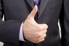 O homem de negócio oferece o Thumbs-Up Fotografia de Stock