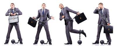 O homem de negócios com os grilhões no branco Imagem de Stock Royalty Free