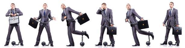 O homem de negócios com os grilhões no branco Imagens de Stock Royalty Free