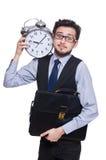 O homem de negócios novo que mantém o despertador isolado Fotografia de Stock