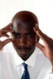 O homem de negócios olha preocupado Fotografia de Stock