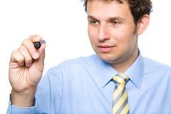 O homem de negócios prende o marcador, desenhando no ar, isolado Fotografia de Stock