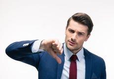O homem de negócios que mostra o polegar assina para baixo Foto de Stock