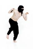 O homem de Ninja guarda a faca e está pronto para atacar no fundo branco Foto de Stock Royalty Free
