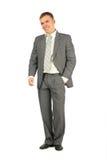 O homem de riso no terno está no fundo branco Foto de Stock Royalty Free