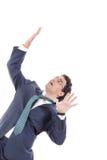 O homem defende-se de não droping algo em sua cabeça Imagem de Stock Royalty Free