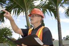 O homem dirige a construção Fotos de Stock Royalty Free