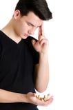 O homem do adolescente concentrou o pensamento de como resolver um bamboozler 3D Fotografia de Stock