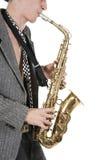 O homem do jazz joga um saxofone Imagem de Stock Royalty Free