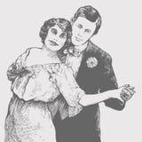 O homem e a mulher dançam um tango Fotos de Stock Royalty Free