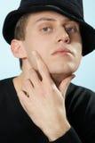 O homem em um chapéu Fotografia de Stock