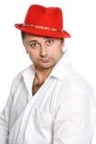 O homem em um chapéu vermelho Imagens de Stock