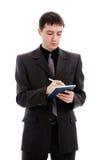 O homem em uma entrada suan em um notebooit, faz Imagem de Stock